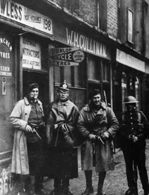 British soldiers, two Auxiliaries and a DMP constable at the Heron and Lawless premises at 198 Parnell Street after the raid. (http://www.standingwellback.com/home/2014/12/30/ira-improvised-munitions-1919-1922.html)
